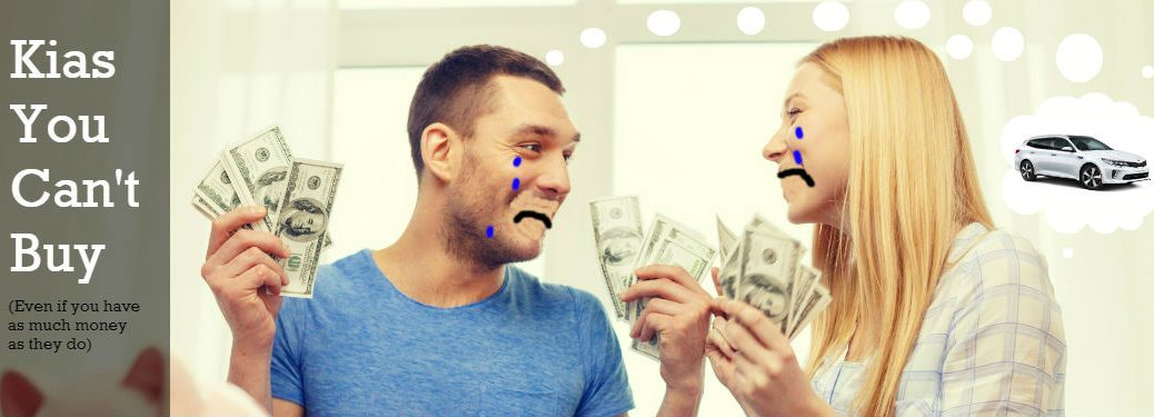 teary couple holding up money and thinking about kia optima wagon