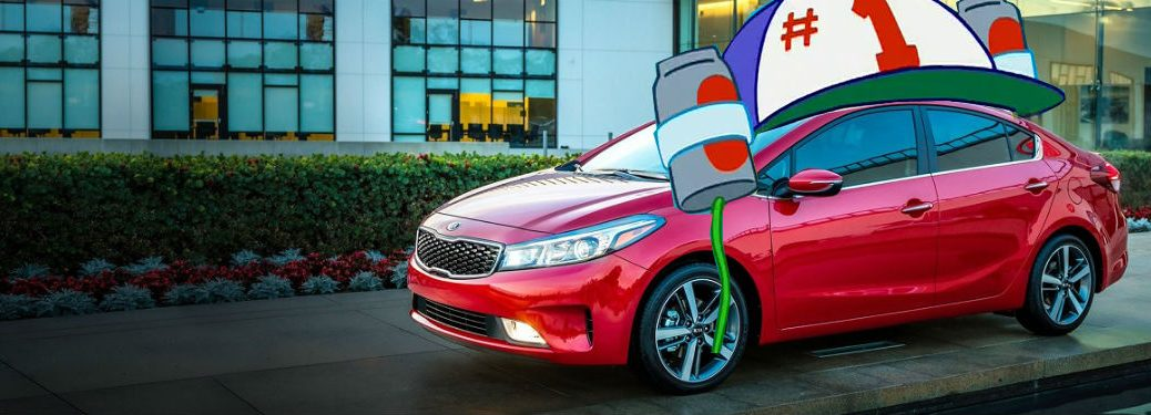 2018 Kia Forte in red parked in front of house