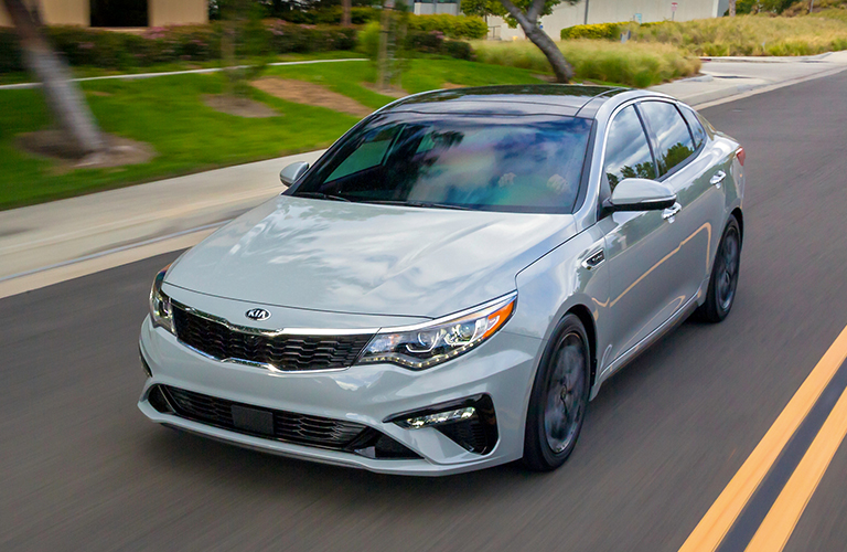 2019 kia optima exterior in pink driving on road