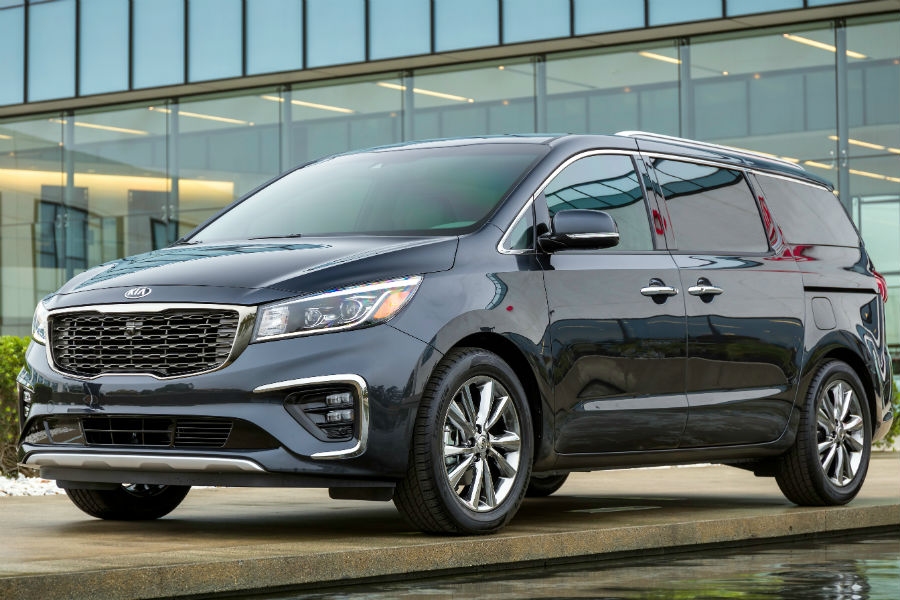 2019 kia sedona exterior parked in front of big nice house