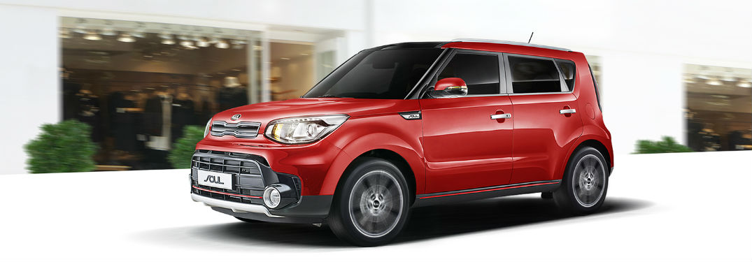2019 kia soul parked in front of stylized storefront