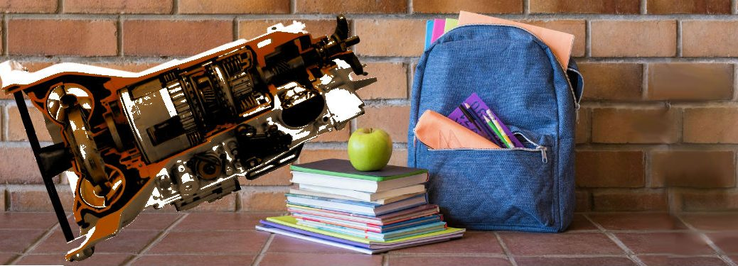 red transmission next to backpack and schoolbooks