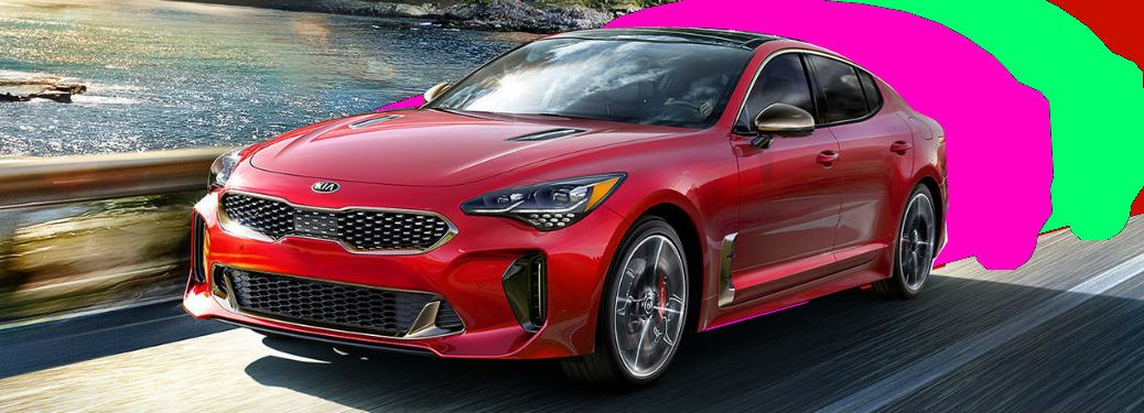 Kia Stinger on highway with color trail in tow