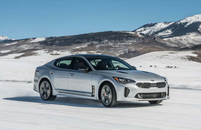 silver 2019 kia stinger parked on a snowbank