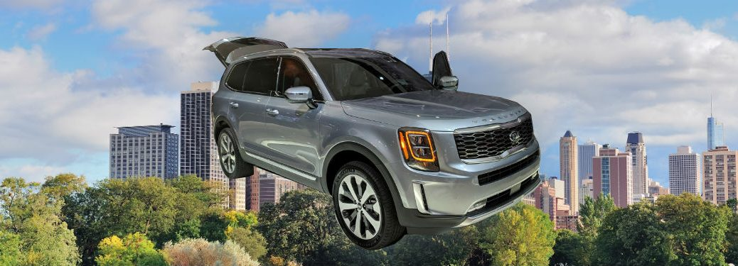 2020 kia telluride in front of chicago city skyline