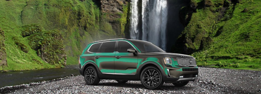 2020 Kia Telluride parked in front of a water fall