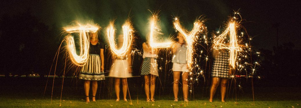 people spelling july 4 with sparklers
