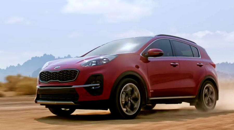 2020 kia sportage in red driving