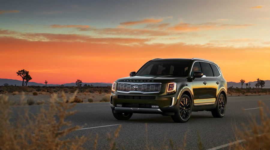2020 Kia Telluride in the desert in front of a sunset