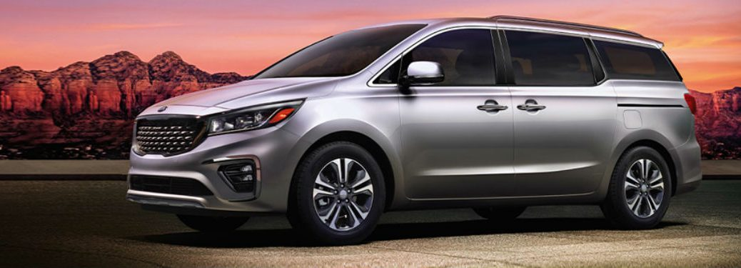 2020 kia sedona in front of a sunset