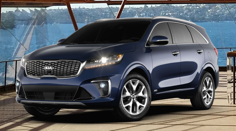 2020 Kia Sorento against operatic background in imperial blue
