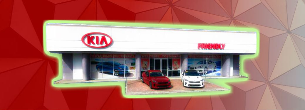 fascia of Friendly Kia against patterned background