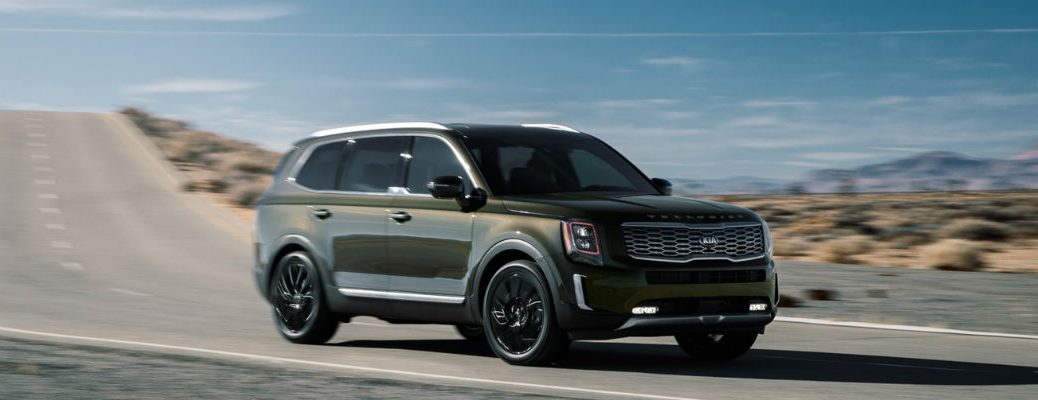 Green 2020 Kia Telluride driving