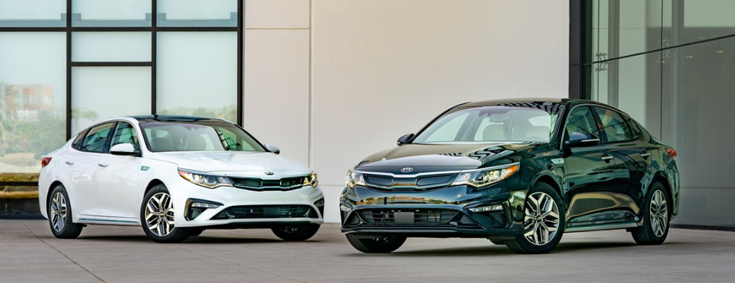 White and black 2020 Kia Optima Hybrid models