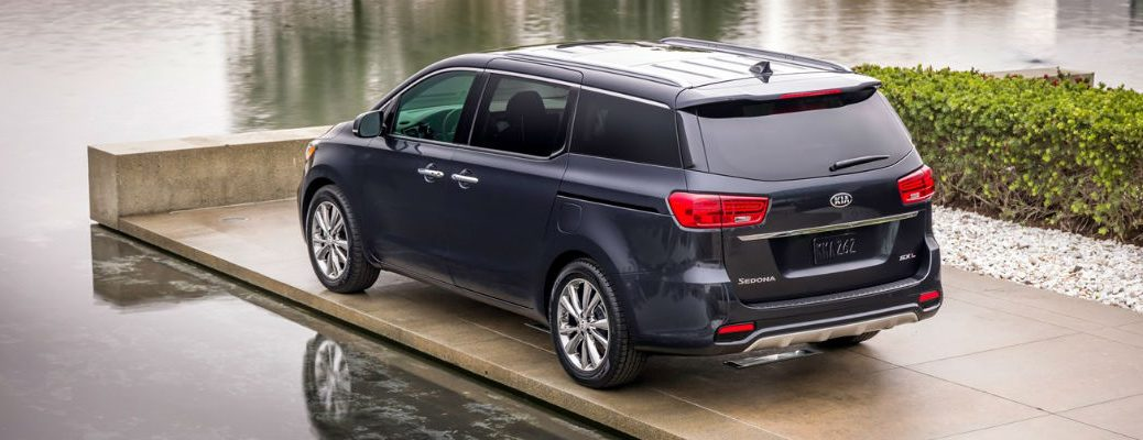Rear view of blue 2021 Kia Sedona
