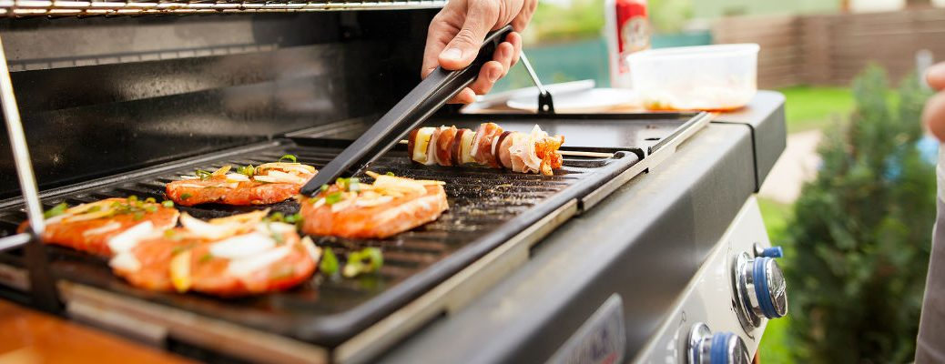 Closeup of person grilling