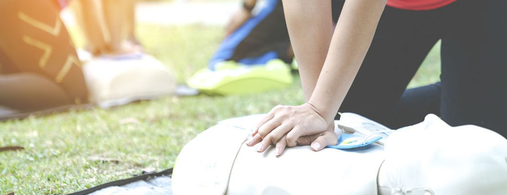 Closeup of individual demonstrating CPR on CPR dummy