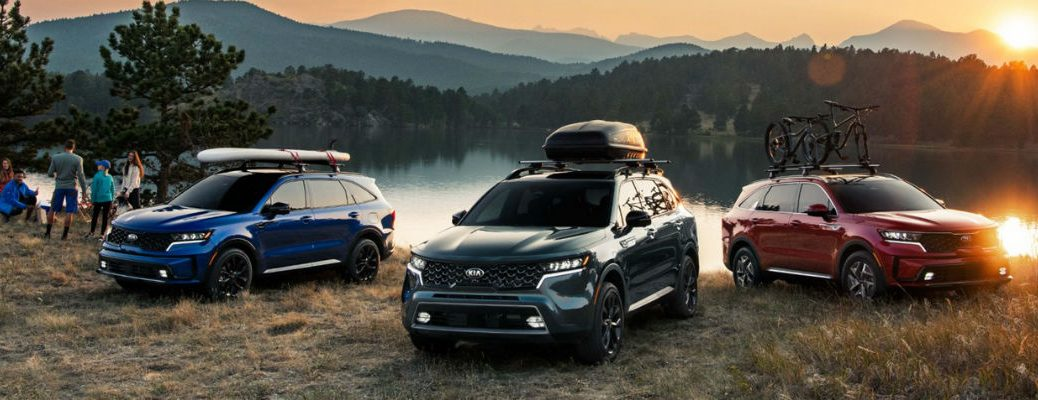 Three 2021 Kia Sorento vehicles in front of water