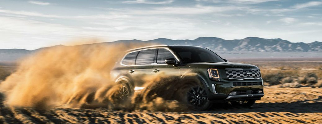 2021 Kia Telluride driving through dirt