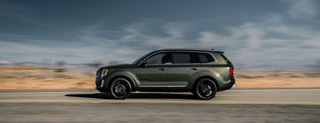 Profile view of green 2021 Kia Telluride