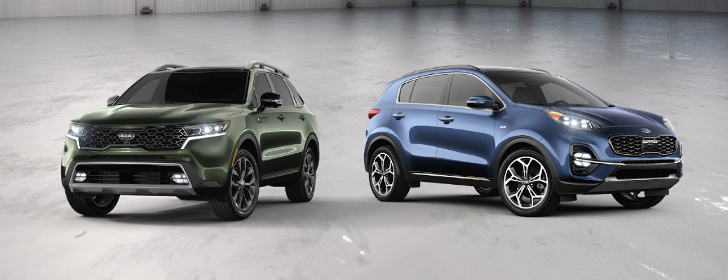 Green 2021 Kia Sorento and blue 2021 Kia Sportage