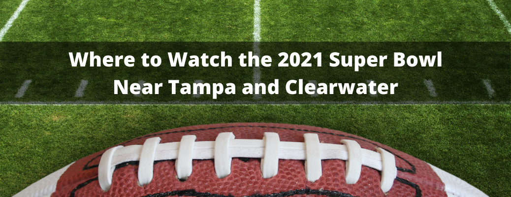 """Closeup of football on field with """"Where to Watch the 2021 Super Bowl Near Tampa and Clearwater"""" white text"""