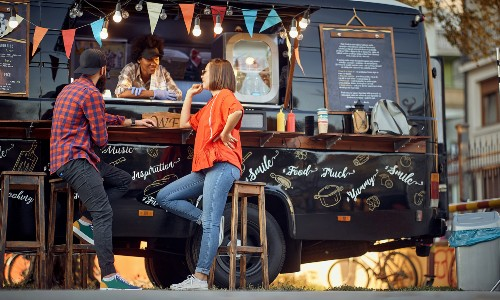 Two customers at food truck