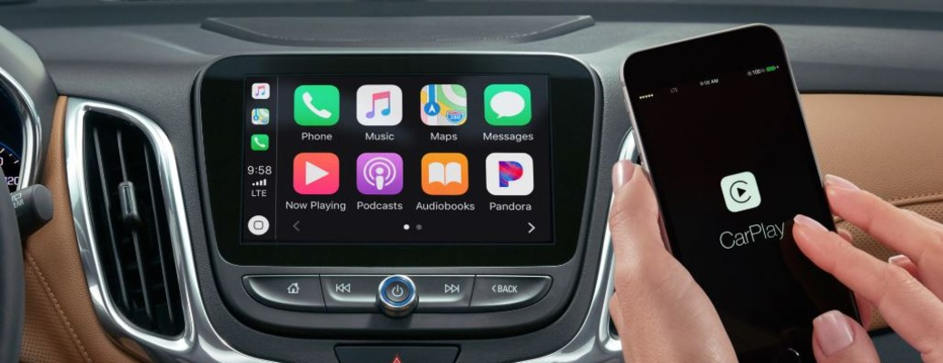 a phone and screen in a vehicle