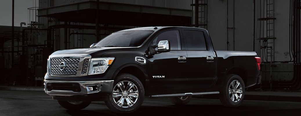 Black 2017 Nissan Titan in front of dark backdrop