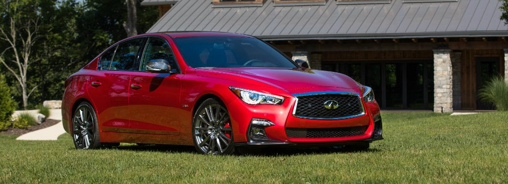Red 2018 Infiniti Q50 parked in grass