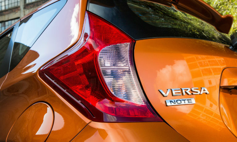 orange versa note, left taillight closeup