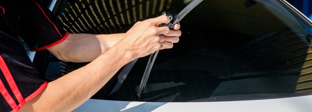 person fixing wiper blade