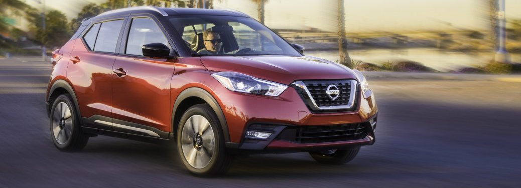 dark orange nissan kicks driving