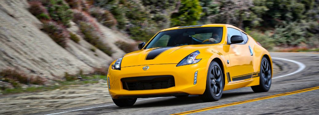 yellow nissan 370z driving