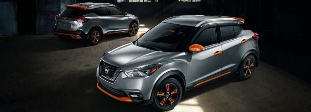 gray nissan kicks with orange trim