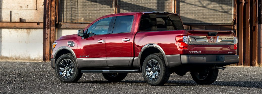 side/rear view of red nissan titan