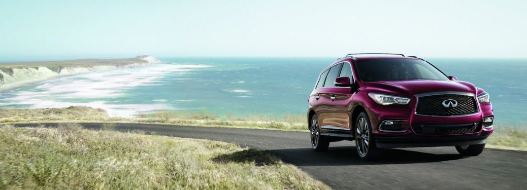 magenta infiniti qx60 driving by water
