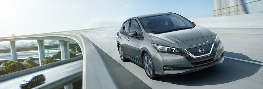 2019 Nissan Leaf driving down highway
