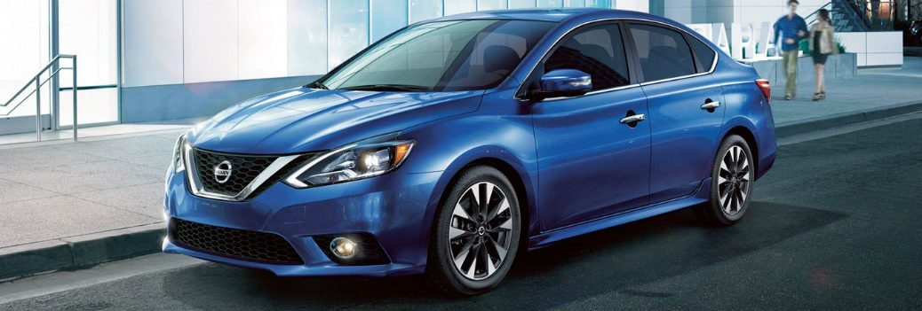 blue 2019 Nissan Sentra driving downtown
