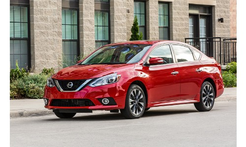 red 2019 Nissan Sentra parked outside brick building