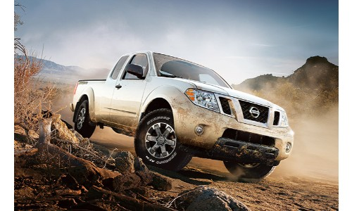 White Nissan Frontier driving off-road