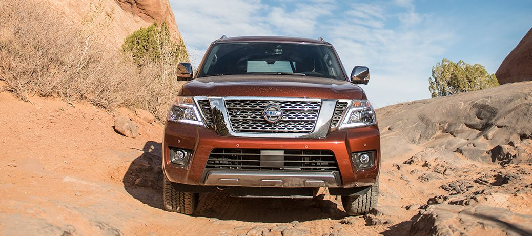 Exterior view of the front of an orange 2019 Nissan Armada parked in the desert