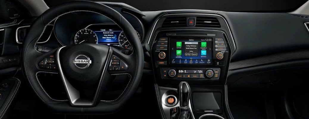 Interior view of the steering wheel and touchscreen inside a 2019 Nissan Maxima