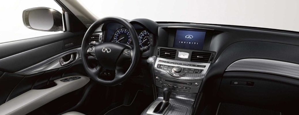 Interior view of the steering wheel and touchscreen inside a 2019 INFINITI Q70L