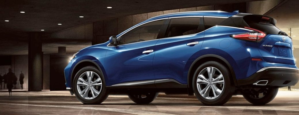 Exterior view of a blue 2019 Nissan Murano parked in an empty showroom