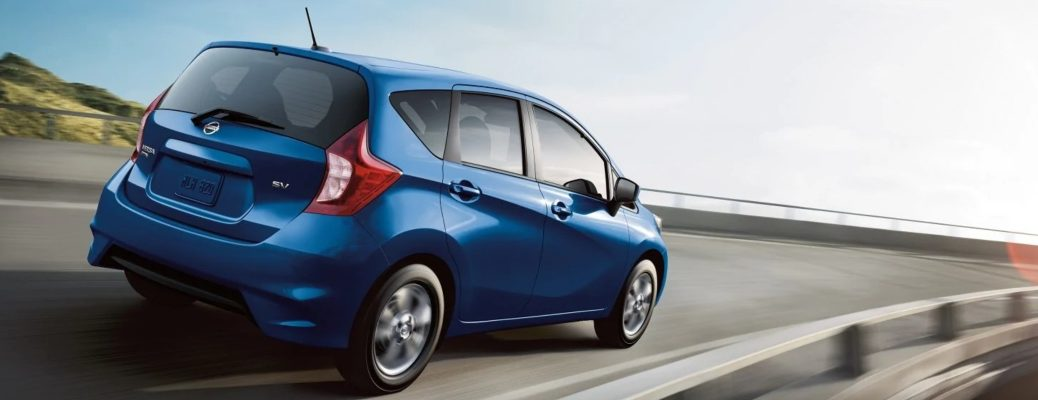 Exterior view of the rear of a 2019 Nissan Versa Note driving down a country highway