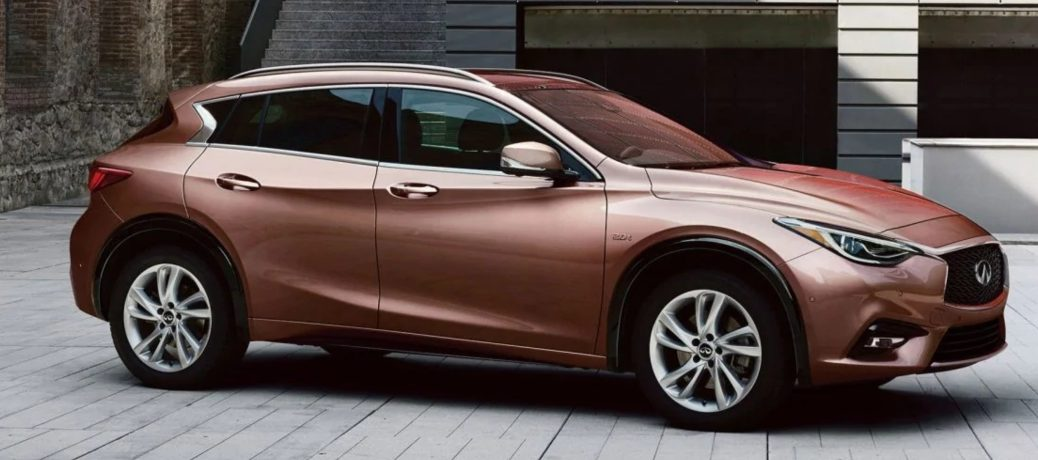 Exterior view of a bronze 2019 INFINITI QX30 parked in a driveway