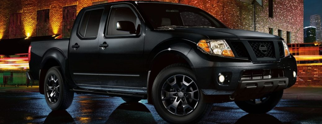 Exterior view of a black 2019 Nissan Frontier Midnight Edition® parked on a city street