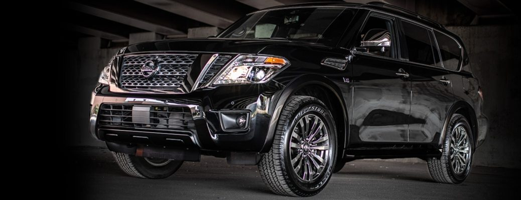 Exterior view of a black 2019 Nissan Armada parked in a garage