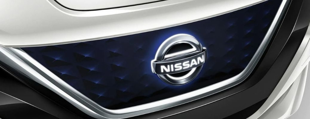 Image of a closeup of an Illuminated Nissan Grille
